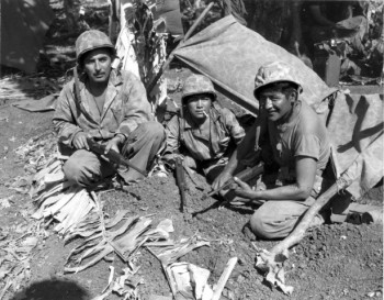Navajo Code Talkers Cpl. Oscar B. Gallup, Pfc. Jack Nez and Pfc. Carl Gorman were among the Marines on Saipan who landed with the first assault waves to hit the beach. The Code Talkers' primary mission was to send and receive encrypted messages, but as a result saw their fair share of combat in the Pacific.(Photo courtesy of U.S. Marine Corps Historical Division)