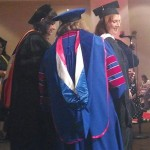 K. Williams receiving her hood for graduation, MALS - Social Arson