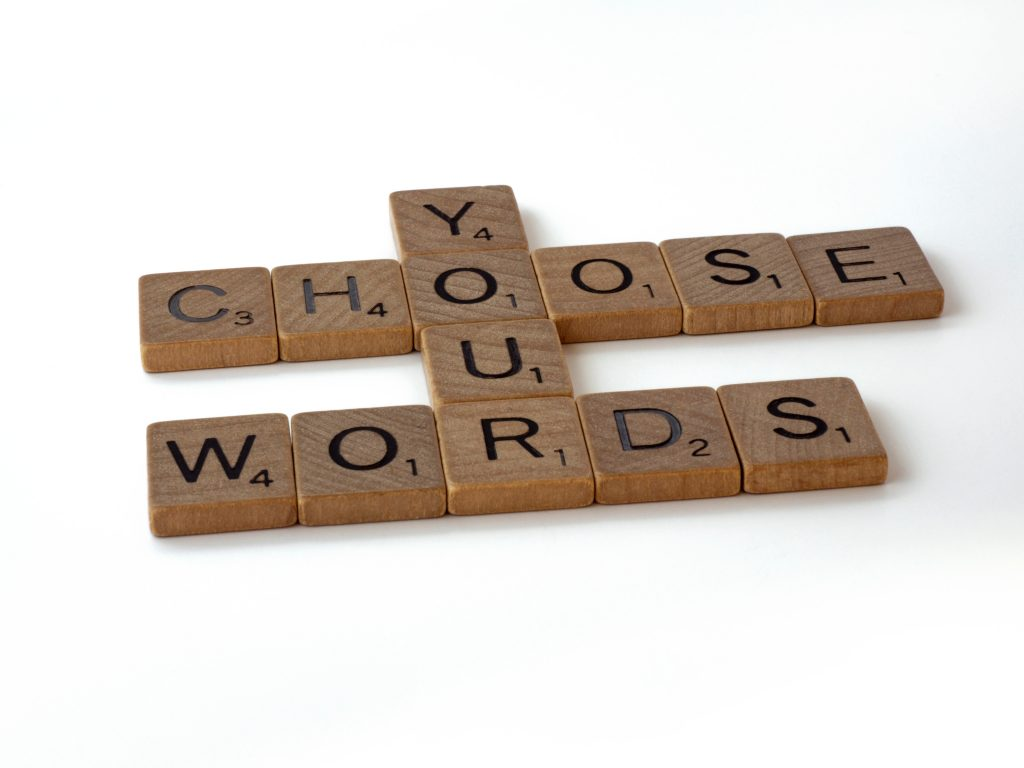 Scrabble tiles saying choose your words.