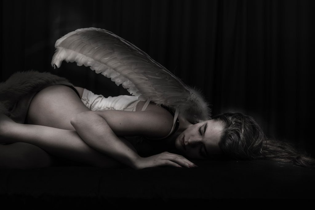 fallen angel lying on the ground