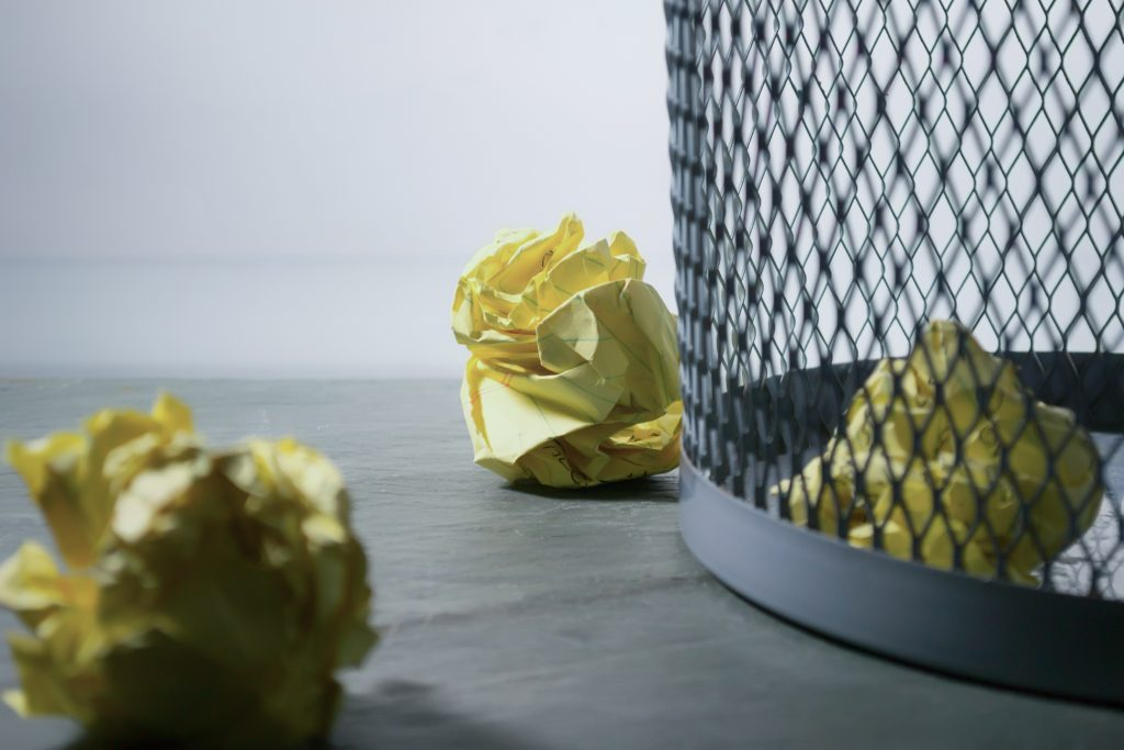 waste basket with crumpled paper