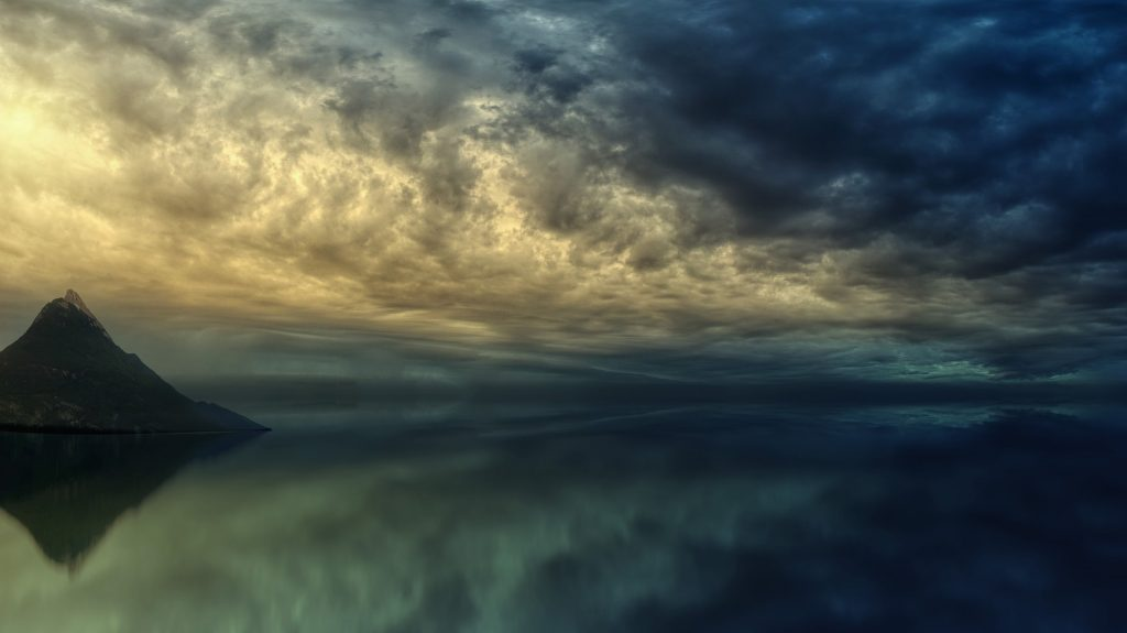 land's edge at the ocean under a stormy sky