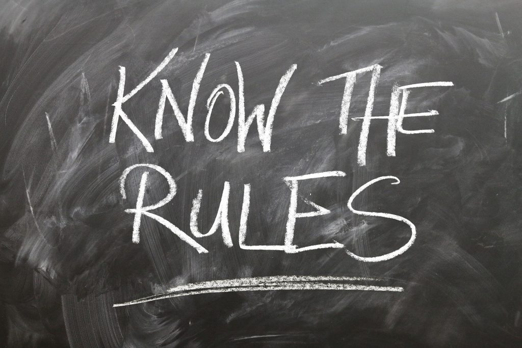 chalk board with know the rules written large
