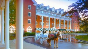 Exterior shot of the Gideon Putnam Hotel with a horse drawn carriage