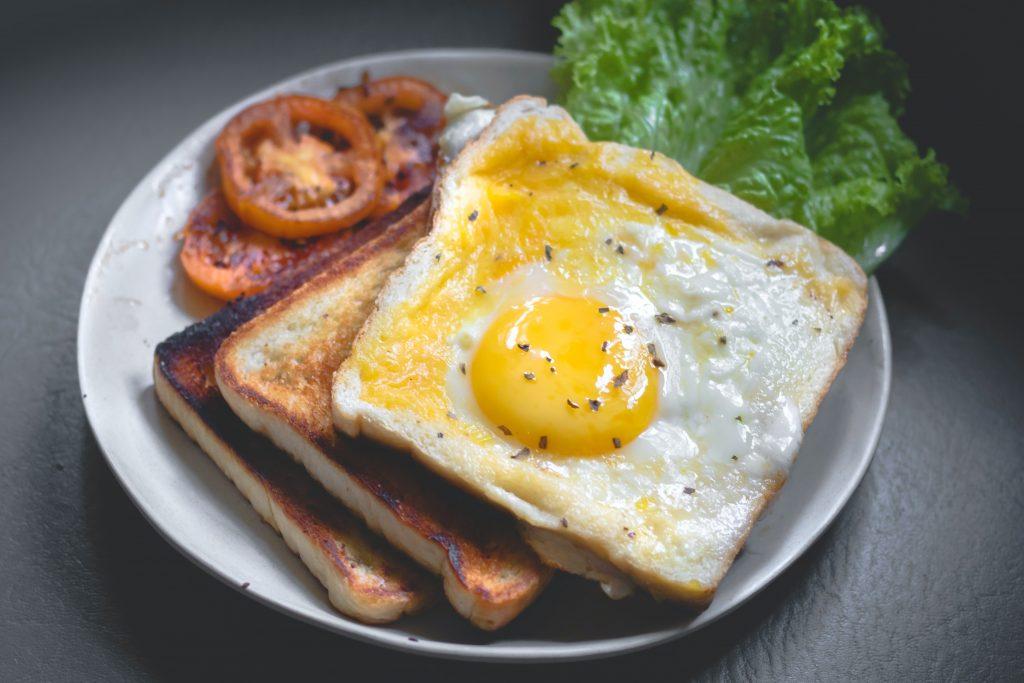 Photo by Eiliv-Sonas Aceron on Unsplash.   Fried egg on toast